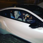 Conor McGregor in a BMW i8 pointing an air-soft gun